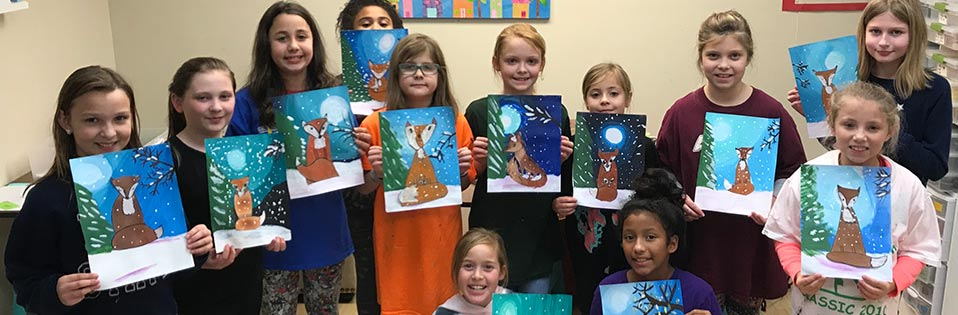 Girls showing off their artwork